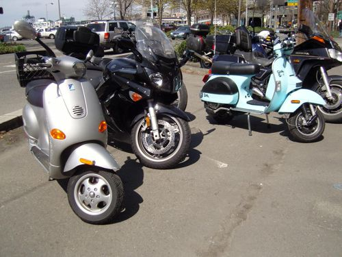 Scooters and motorcycles parked near the Viaduct