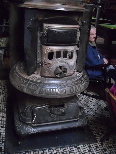Wood-burning stove at McMenamins Olympic Club