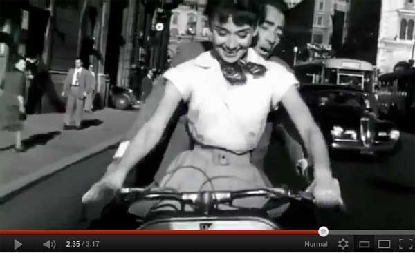 Audrey Hepburn and Gregory Peck on a Vespa