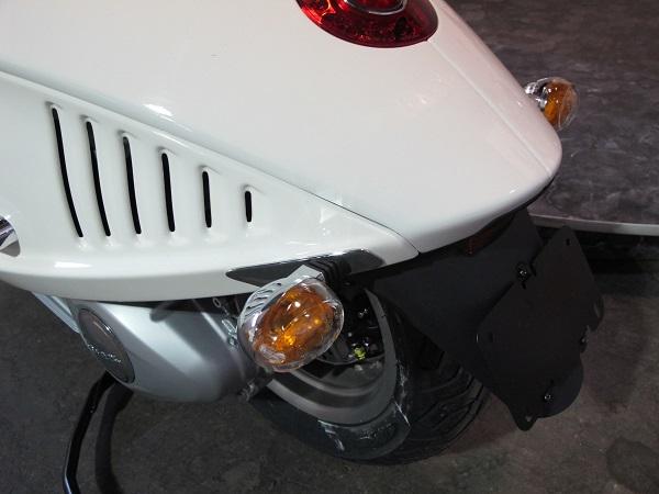 Tacked-on rear blinker