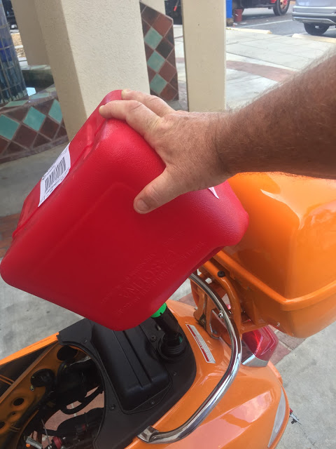 Filling up via gas can